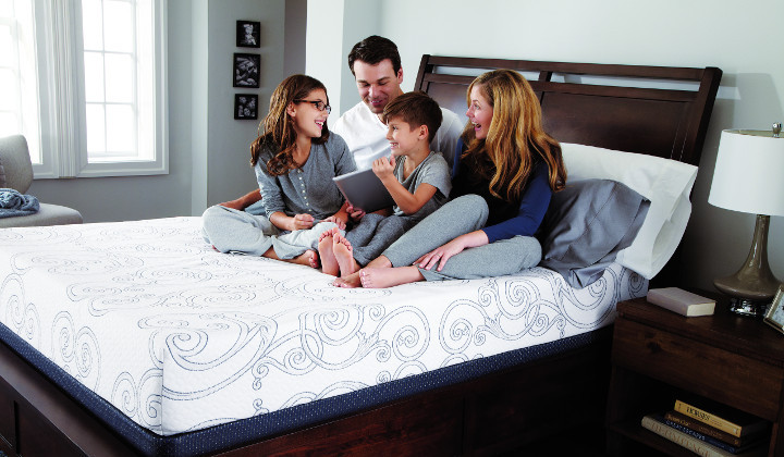 Family relaxing on mattress